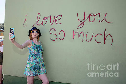Herronstock Prints - An Austin local takes a selfie at the famous I love you so much mural in South Congress Austin Texas