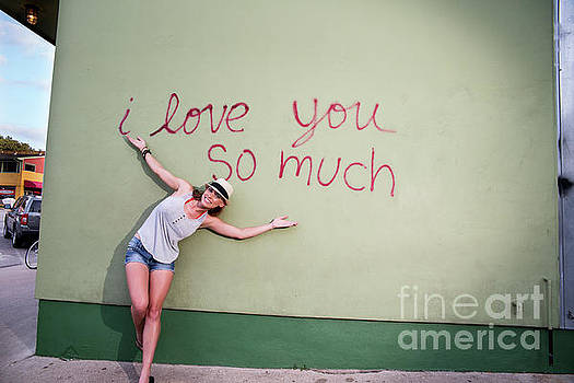 Herronstock Prints - An local Austin woman poses in front of the famous I love you so much