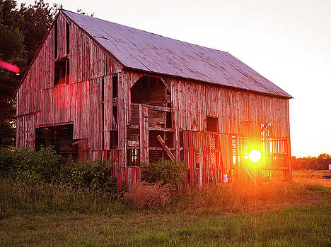 An old barn glow by Shawn M Greener