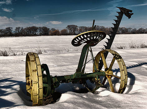 An old mower in the snow by Jeff Swan