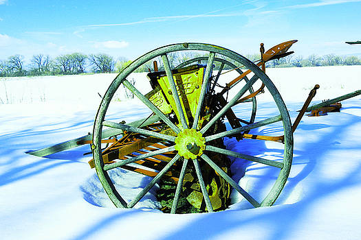 An old rake in the snow by Jeff Swan