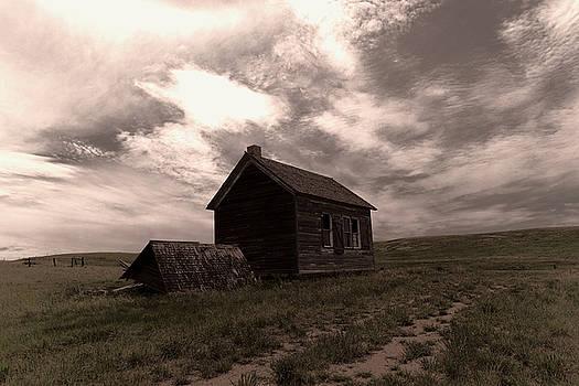 An old wooden house near Alexander North Dakota by Jeff Swan