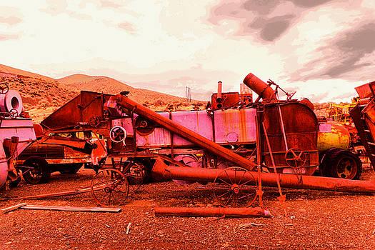 An old rusty harvestor by Jeff Swan