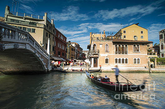 Ancient buildings and boats in the channel in Venice by Deyan Georgiev