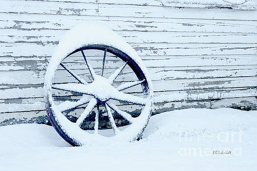 Antique Wheel in the Snow by E B Schmidt