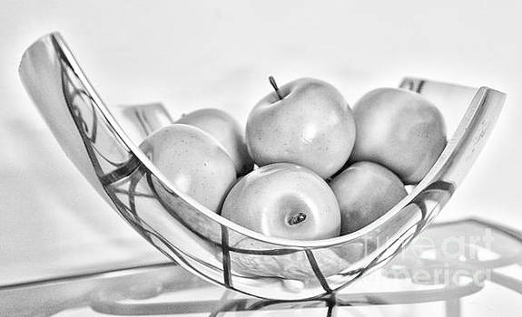 Apples In A Bowl On A Table by Brian Mollenkopf