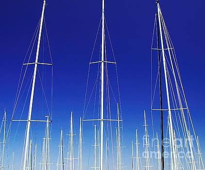Artistic. Yacht Masts Reaching into a Vivid Blue Sky. by Geoff Childs