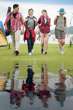 Asian friends group walk togather by Anek Suwannaphoom