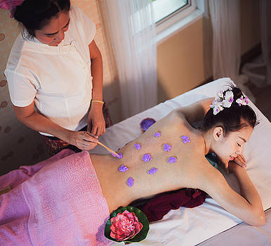 Asian lady relax in skin care aroma therapy and  scrub spa by Anek Suwannaphoom