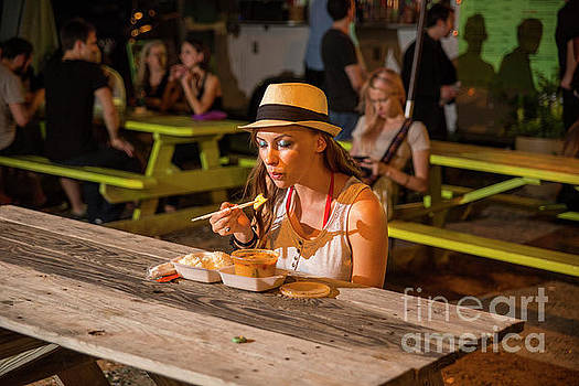 Herronstock Prints - Attractive Austin local eats dinner at an East Austin food trailer park offering delicious cuisine