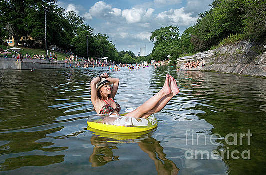 Herronstock Prints - Attractive Austin local enjoys the warm sun rays and cool waters