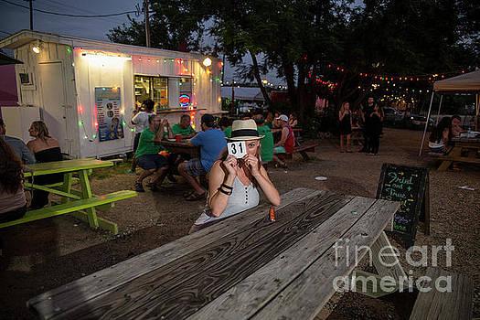 Herronstock Prints - Attractive Austin tourist enjoys delicious cuisine at an East Austin food trailer park