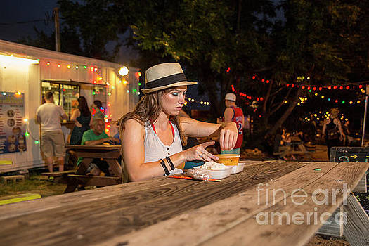 Herronstock Prints - Attractive local Austin woman resident eats at an East Austin food truck park