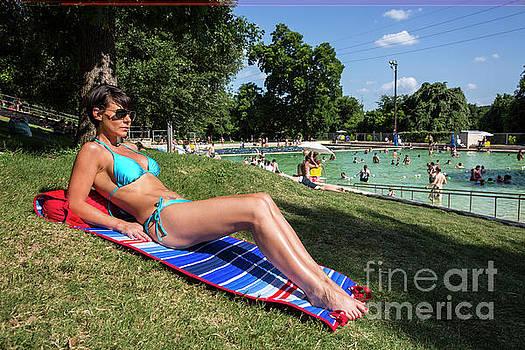 Herronstock Prints - Attractive model in bikini at Deep Eddy Pool, sunbathing on sunny day in Austin, Texas