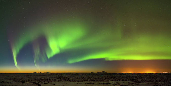 Aurora above Keflavik in Iceland. by Andy Astbury