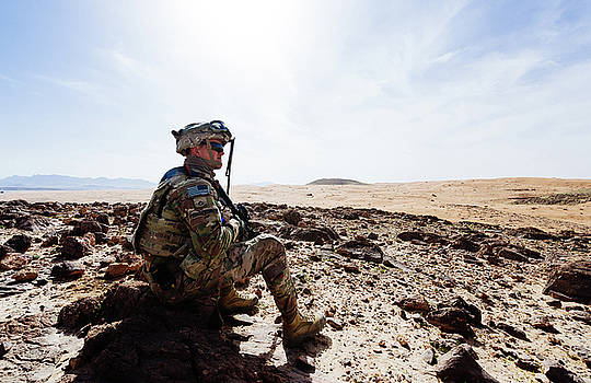 AUS Soldier surveys a training ground near Kandahar Afganistan  by Paul Fearn