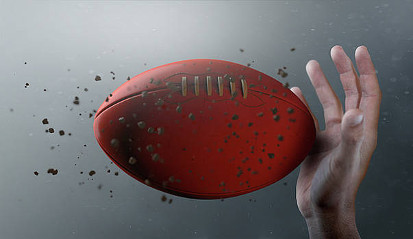 Aussie Rules Ball In Flight by Allan Swart