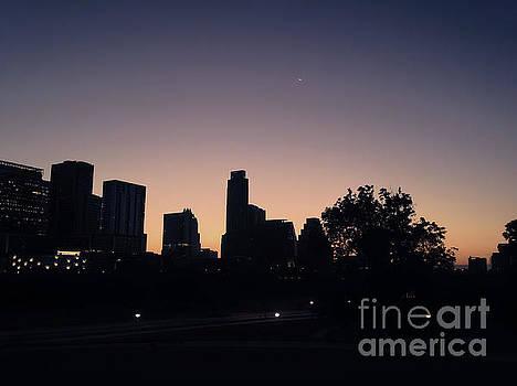 Austin Skyline Sunrise Into A Crescent Moon by Felipe Adan Lerma