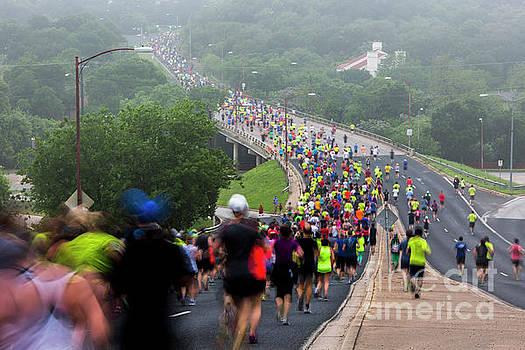 Herronstock Prints - Austins Cap10K runners make their way down Enfield Road on a foggy morning