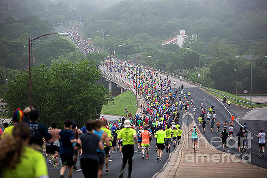 Herronstock Prints - Austins Cap10K runners make their way down the windy Enfield Road on a foggy morning