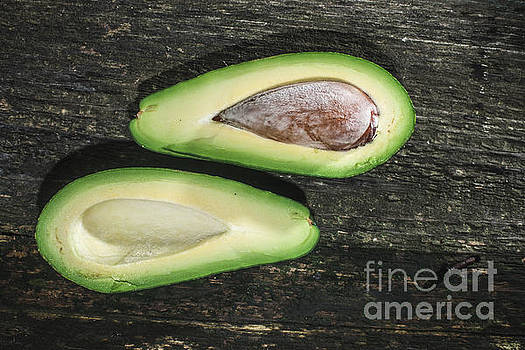 Avocado on wood by Deyan Georgiev