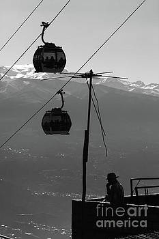 Aymara Man Chewing Coca Leaves Under Cable Cars La Paz Bolivia by James Brunker