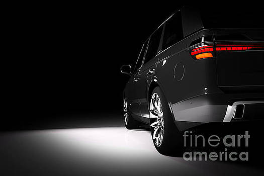 Michal Bednarek - Back view of modern black SUV car in a spotlight