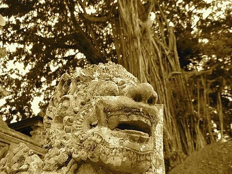 Bali statue in orange - front profile by Exploramum Exploramum