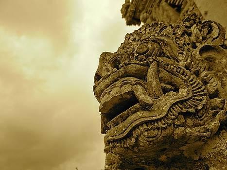Bali statue in orange - side profile by Exploramum Exploramum