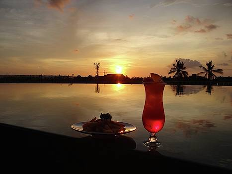Balinese orange sunset with drink by Exploramum Exploramum