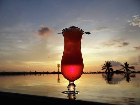 Balinese sunset with red drink by Exploramum Exploramum