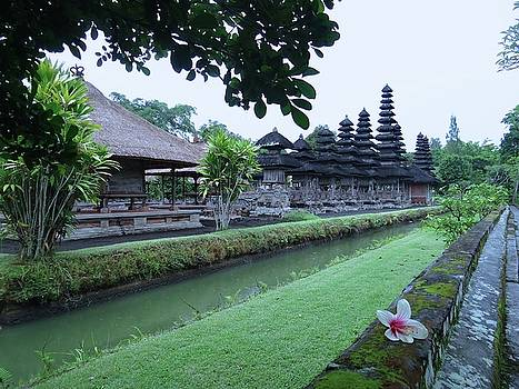 Balinese Temple with flower by Exploramum Exploramum