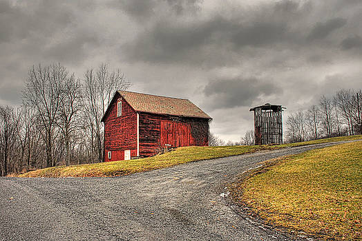 Barn in Winter Storm by Tony  Bazidlo