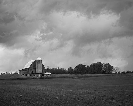 Barn with Storm Clouds by Kimberly Kotzian