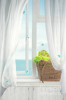 Beach Basket In Window by Amanda Elwell