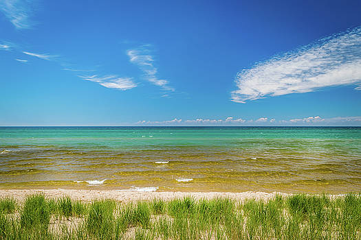 Beach With Blue Skies and cloud by Lester Plank