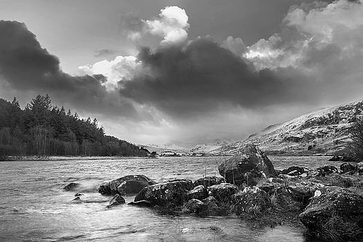 Beautiful  black and white Winter landscape image of Llynnau Mym by Matthew Gibson