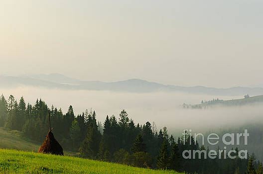 Beautiful Carpathians with a foggy mountain. by Iryna Soltyska