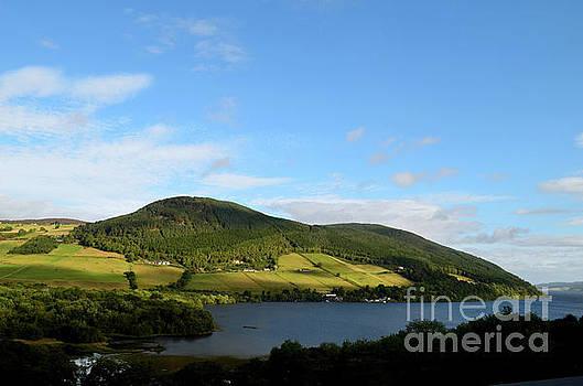 Beautiful Green Rolling Hills Surrounding Loch Ness in Scotland by DejaVu Designs
