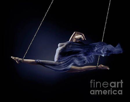 Beautiful naked woman suspended in a split with bondage ropes wi by Oleksiy Maksymenko