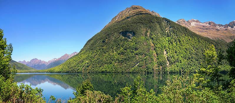 Beautiful reflections at Lake Gunn, NZ by Daniela Constantinescu