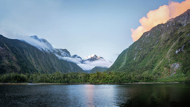 Beautiful sunset color at Harrison Cove in Milford Sound by Daniela Constantinescu