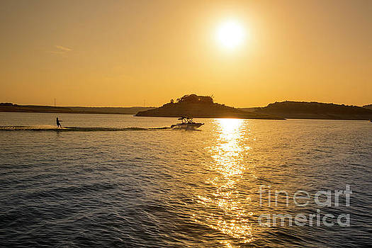 Herronstock Prints - Beautiful sunset falls on Lake Travis this popular lake attracts water skiers from around the country
