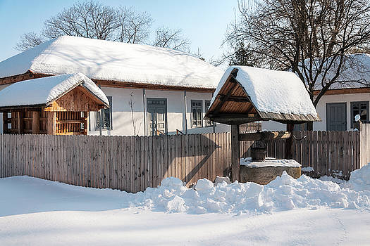 Beautiful traditional Romanian house covered in snow by Daniela Constantinescu