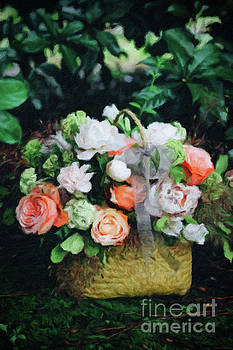 Beautiful white and coral colored flowers in a basket by Amy Cicconi