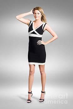Beautiful woman wearing black and white dress by Jorgo Photography - Wall Art Gallery