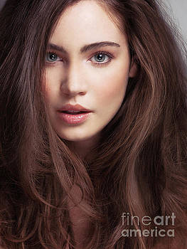 Beauty face portrait of a young woman with long brown hair and g by Oleksiy Maksymenko