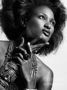 Beauty portrait of african american woman wearing jewellery blac by Oleksiy Maksymenko