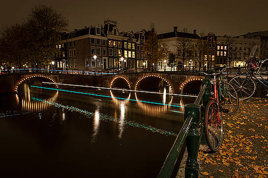 Bicycle parked at the Canals by Wim Slootweg