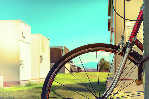 Bicycle Parked in Downtown Reno, Nevada with a Teal Sky on a Summer Afternoon by Brian Ball